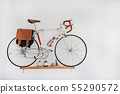 Decorative bicycles hanging on white wall. 55290572