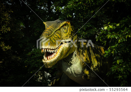 Big green tyrannosaurus in green of the forest  55293564