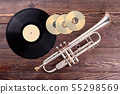 Vinyl record, cd discs and trumpet. 55298569