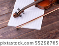 Violin with bow and music notes. 55298765