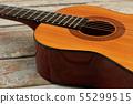 Acoustic guitar close up. 55299515
