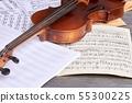 Sheets of musical symbols and violin. 55300225