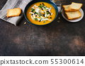 Top view of border made of traditional pumpkin soup and bread on dark vintage wooden background. 55300614