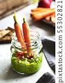 Spinach Hummus in a glass jar 55302821