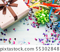 Pink gift with ribbon on confetti background 55302848