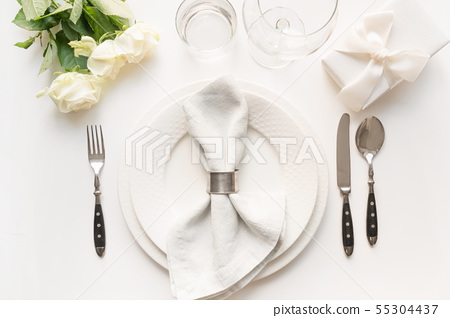 White table setting with bouquet rose, gift. 55304437