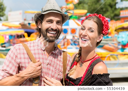 Couple having fun on Bavarian fair or Oktoberfest 55304439