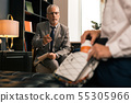 Calm psychotherapist reaching out his hand for pills 55305966