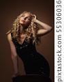blonde fashion woman in gorgeous black dress 55306036