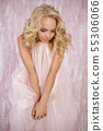 curly blonde woman in gorgeous pink dress 55306066