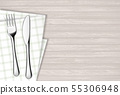 Fork and table knife on a napkin. Wooden table. 55306948