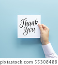 woman hand holding card with the word thank you 55308489