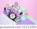 A white cosmetics bag with makeup products 55312483