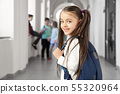 Pretty girl with funny hairstyle on corridor in school. 55320964