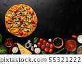 Delicious pizza with tomatoes and herbs on black table 55321222