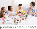 Stem education. Children creating robots with teacher 55321224