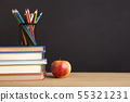 Office stationery and fresh apple over chalk board 55321231