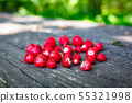 Wild strawberries fresh picked on wooden table close up 55321998