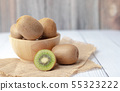 kiwi fruits in a bowl place on the wooden table 55323222