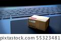 Single cardboard parcels box lying on a notebook 55323481