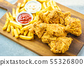 Fried chicken wings with french fries and tomato or ketchup and mayonnaise sauce 55326800