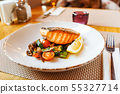 salmon with roasted vegetables, dinner in the restaurant 55327714