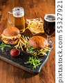 Homemade beef burger with crispy bacon and vegetables on rustic serving board 55327921