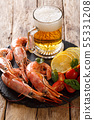 glass of beer and delicious shrimps, lemon and 55331208