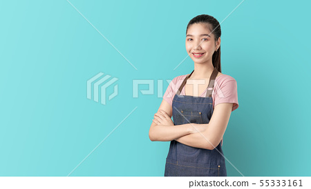 Small business, Asian woman in apron and standing. 55333161