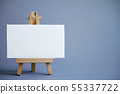 A miniature easel with a white board for writing, 55337722