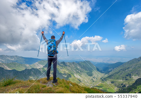 Successful active man hiker on top of mountain 55337940