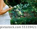 Wedding bouquet in bride holding her bouquet 55339421