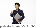 man holding Computer laptop and showing thumbs up 55340765