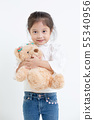 Portrait of little Asian girl hugging teddy bear 55340956