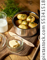 Young potatoes boiled in  pot with dill and butter on wooden board 55341518