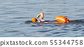 Women swimming in the bay with an orange safety 55344758