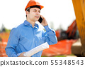 Engineer talking at the phone in a construction 55348543