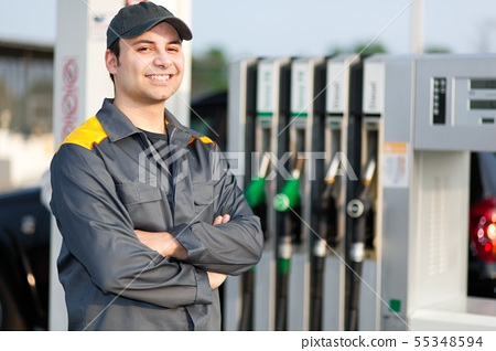 Smiling gas station worker 55348594
