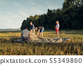 Family set up tent camp at sunset, beautiful 55349860