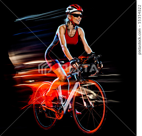woman triathlon triathlete cyclist cycling isolated black background 55354822