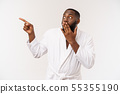 Black guy wearing a bathrobe pointing finger with surprise and happy emotion. Isolated over whtie 55355190