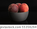 Fresh red peach isolated on black glass 55356264