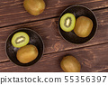 Fresh green kiwi on brown wood 55356397