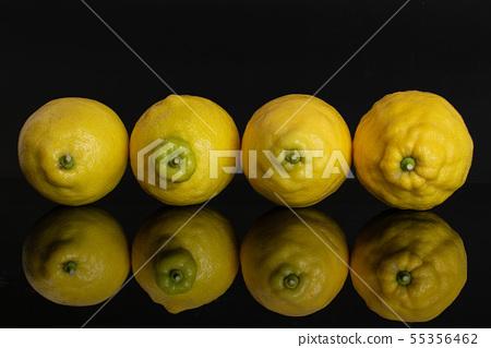 Fresh yellow lemon isolated on black glass 55356462