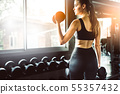 Young girl playing dumbbell to exercise in 55357432