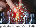 Businessman hold a chess king on hand with digital 55364582