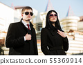 Young business couple walking on the city street 55369914
