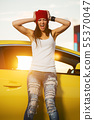 Angry fashionable punk woman standing at the car 55370047