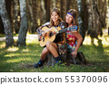 Two hippie girls with guitar in a summer forest 55370096
