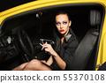 Fashion woman smoking a cigarette in a car 55370108